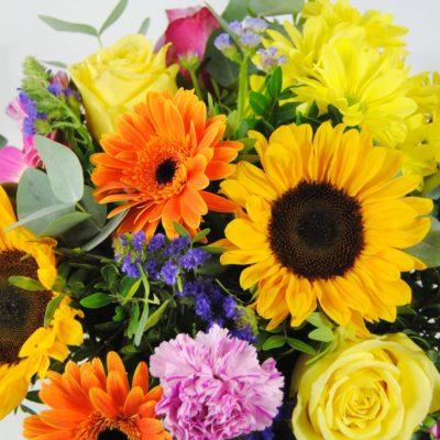 Ramos De Flores - Girasoles, Gerberas Fucsia, Gerbera Naranja, Flores Margarita Amarilla, Clavel Jaspeado, Rosa Amarilla, Rosa Fucsia, Estaticeazul, Eucalipto